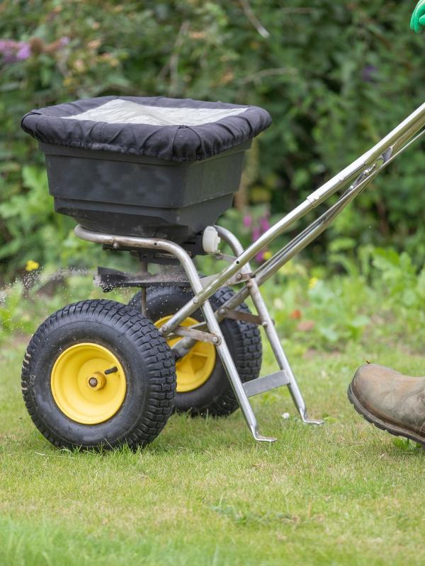 Brownstown worker seeding residential lawn