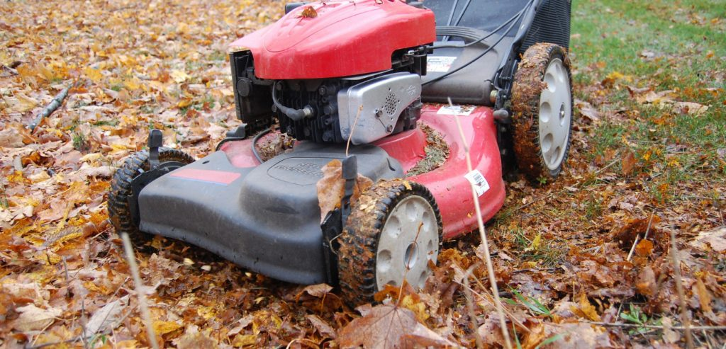 A Brownstown homeowner mowing debris-filled lawn in the Fall