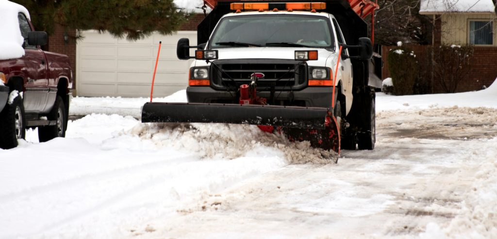 Removing snow in a Brownstown neighborhood