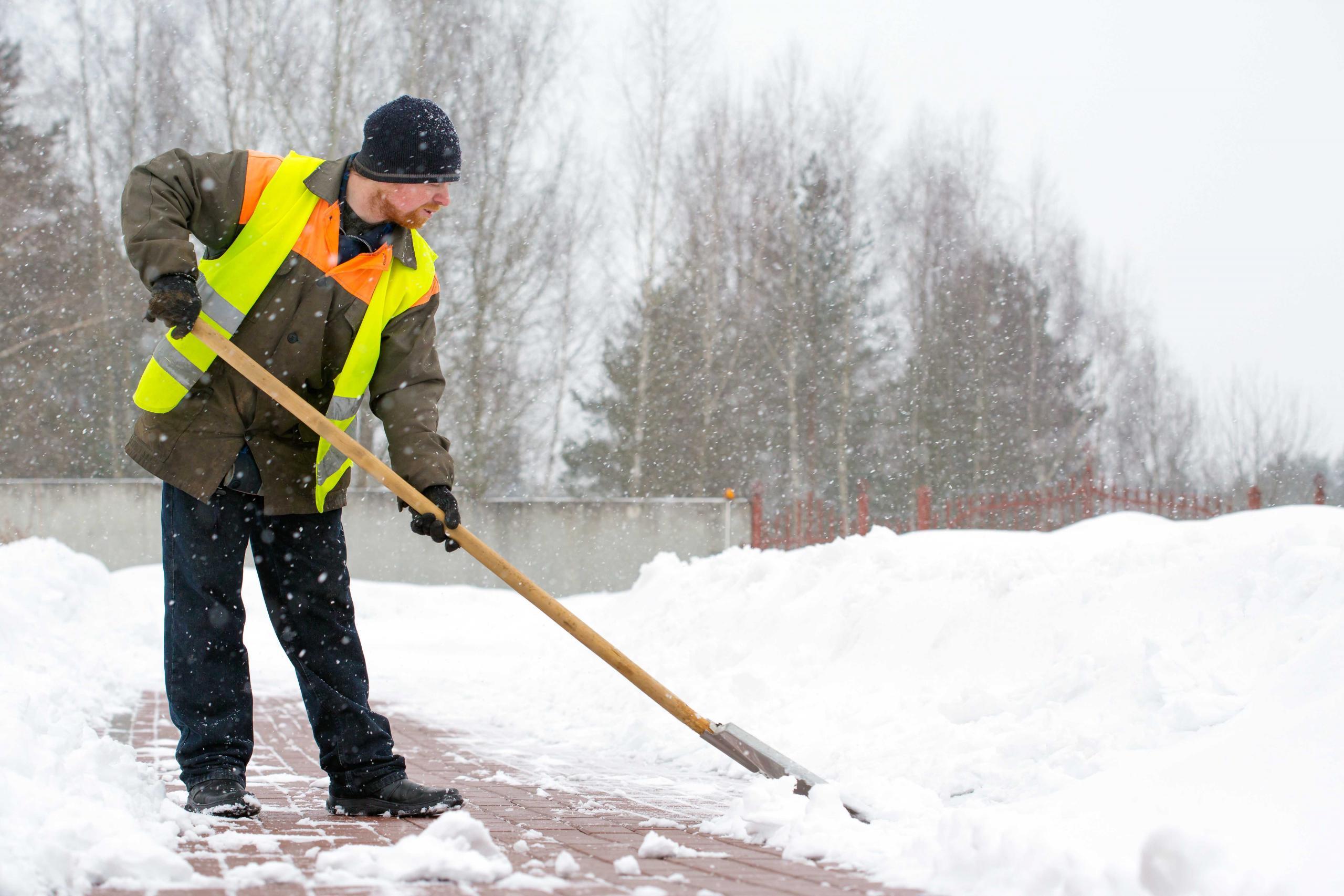 Cleaning snow off sidewalk